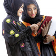 Muslim asian female students with tablet computer — Stockfoto