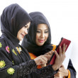 Muslim asian female students with tablet computer — Stock Photo