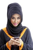 Muslim businesswoman with mobile phone — Stock Photo