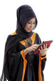 Muslim asian female student with tablet computer — Stock Photo