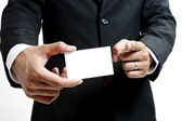 Business man holding blank note card — Stock Photo