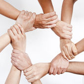 Small group of business people joining hands — Foto de Stock