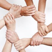 Small group of business people joining hands — Stock fotografie