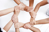 Small group of business people joining hands — Stock Photo
