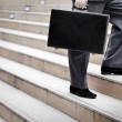 Businessman standing with a briefcase,outdoor. — Stock Photo