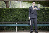Businessman waiting at the bus stop — Stock Photo
