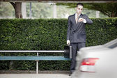 Businessman waiting for the bus — Foto Stock