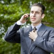 Usinessman holding his mobile phone against his ear — Stock Photo