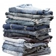 Lot of different blue jeans — Stock Photo