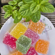 Green bush of fresh mint and candied fruit jelly — Stock Photo