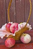 Apples in a wicker basket — Stock Photo