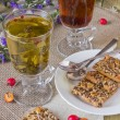 Stock Photo: Glasses with different herbal teas and cookies