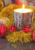 Christmas candle and decorations — Stock fotografie