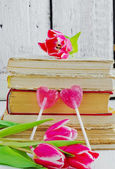Tulips and valentines on the books — Stock Photo