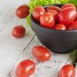 Cherry tomatoes and lettuce — Stock Photo