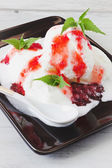 Ice cream with strawberry jam  — Stock Photo