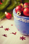 Christmas balls in blue bowl  — Stock Photo