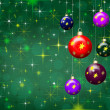 Christmas green background with stars and baubles — Stock fotografie
