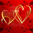 Hearts of gold on a red gradient background — Stock Photo #39797137