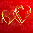 Hearts of gold on a red gradient background — Stock Photo #39797139