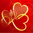Hearts of gold on a red gradient background — Stock Photo #39797147