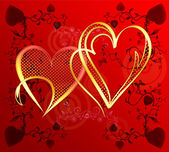 Hearts of gold on a red gradient background — Stock Photo