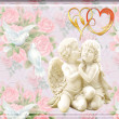 Angels in love on a gentle flower background — Stock Photo #39863091