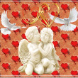 Angels in love and white pigeons against from hearts — Stock Photo