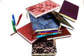 Scattered notebooks and pens in flight — Stock Photo
