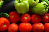 Tomatoes, cucumbers, peppers — Stock Photo