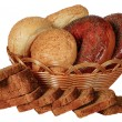 Stock Photo: Composition with bread and rolls in wicker basket isolated on white
