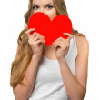 Young woman holding Valentines Day heart sign with copy space — Stock Photo #27675781