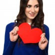 Young woman holding Valentines Day heart sign with copy space — Stock Photo #27675791