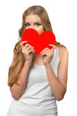 Young woman holding Valentines Day heart sign with copy space — Stock Photo