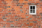 Red brick wall with window — Stock Photo
