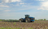Blue Tractor Plowing — Stock Photo