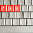 Stock Photo: Scam word spelled on metallic keyboard