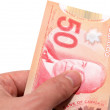 Hand holding 50 Canadian dollars — Stock Photo #27754725