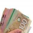 Hand holding a series of Canadian banknotes with 100 dollars on — Stock Photo