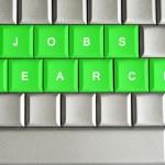 Jobs search spelled on a metallic keyboard — Stock Photo #27757093