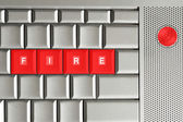 Fire spelled on keyboard — Stock Photo