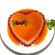 Heart shape flan caramel with strawberries and mint leaves — Stock Photo