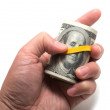 Roll of us banknotes with 100 dollars at the surface — Foto Stock