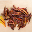 Dried red chili and yellow fresh chili on wooden cut board — Stock Photo #31512145