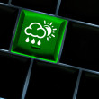 Online weather Concept with back lit keyboard — Stock Photo