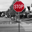 Stock Photo: Stop sign at street corner with pedestricross path