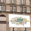 Advertising billboard with DDOS word cloud sign on brick wall — Stock Photo #38263239