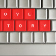 Stock Photo: Love story spelled on metallic keyboard