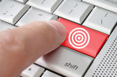 Business concept male finger hitting target enter key — Stock Photo