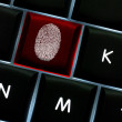 Onliine crime scene concept with fingerprint left on backl — Stock Photo #39881335